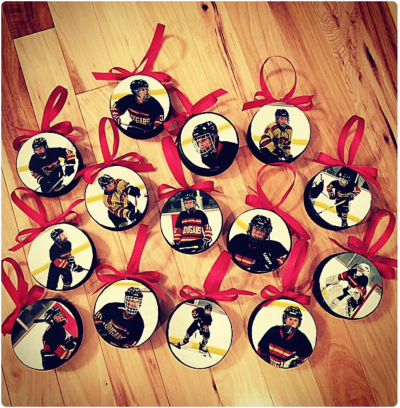 print some action shots of the team and make them into hockey puck ornaments these are bound to brighten up the christmas